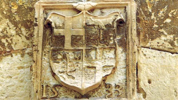 The original armorial shield dated 1533 of Grand Master Philippe Villiers de L'Isle Adam still appears in the corridor of the Knights' Holy Infirmary.