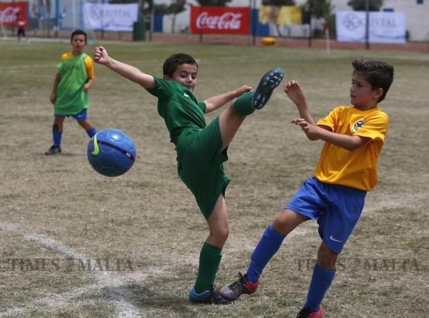 Children play football during the Puttinu Cares annual fund raising sports marathon at the Marsa sports grounds on May 29. Photo: Darrin Zammit Lupi