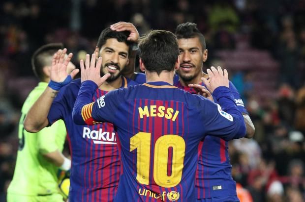 Barcelona's Paulinho celebrates scoring their third goal with Lionel Messi and Luis Suarez.