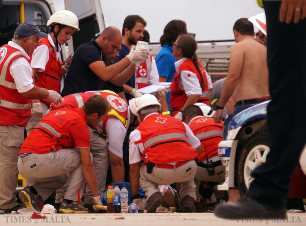 Red Cross volunteers provide first aid to victims of the crash during the Papqaqli ghall-Istrina charity event at Malta International Airport on October 4. 28 people were injured, some critically, when a Porsche 918 Spyder supercar crashed into bystanders. Photo: Steve Zammit Lupi