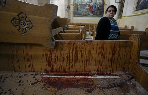 A bloody church pew following one of the attacks. Photo: Reuters/Mohamed Abd El Ghany