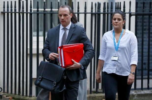 Britain's Secretary of State for Exiting the European Union, Dominic Raab, leaves 10 Downing Street, in London.