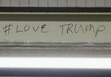 Police nab pro-Trump graffiti artist with fake wall