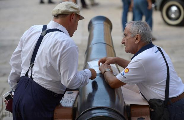Two men dressed in period clothing during Mdina Grand Prix Concours D' Elegance in Mdina on October 7. Photo: Matthew Mirabelli