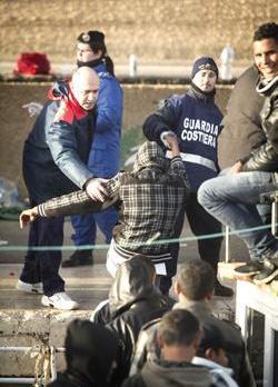 Tunisian immigrants disembarking at Lampedusa early on Monday. Photo: Roberto Salomone/AFP