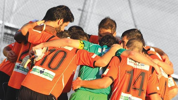 Unity... Swieqi United players do their customary pre-match huddle.