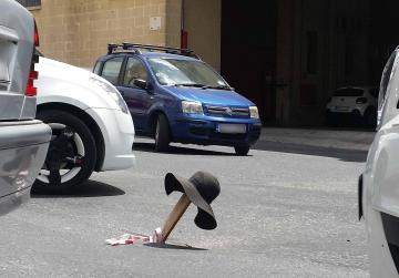 An improvised 'roundabout' for an Mrieħel pothole