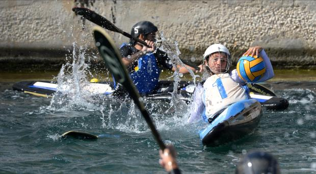 Two players compete for the ball during a canoe polo match at Dock 1 in Cospicua on October 22. Photo: Matthew Mirabelli