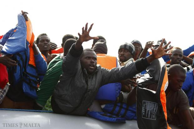 A sub-Saharan African migrant pleads for a lifejacket during the rescue of 106 migrants on a rubber dinghy off the Libyan coast by NGO Migrant Offshore Aid Station (Moas) on October 4. Photo: Darrin Zammit Lupi/Moas