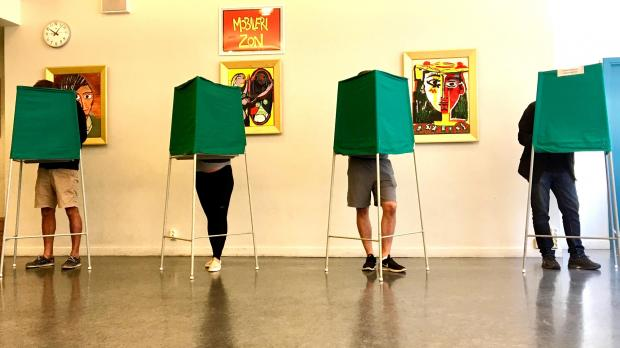 Voters mark their candidates at a polling station in Stockholm. Photo: Reuters