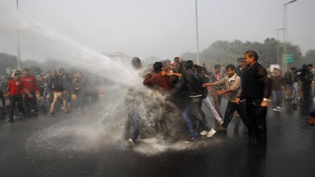 Indian police use water cannon to disperse protesters demonstrating against a gang rape and brutal beating of a 23-year-old student on a bus in New Delhi. The attack last Sunday has sparked days of protests across the country. Photo: Tsering Topgyal
