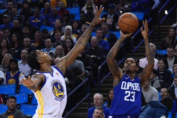 Los Angeles Clippers guard Lou Williams (23) shoots the basketball against Golden State Warriors guard Nick Young (6) during the first quarter at Oracle Arena. Photo: Kyle Terada-USA TODAY Sports