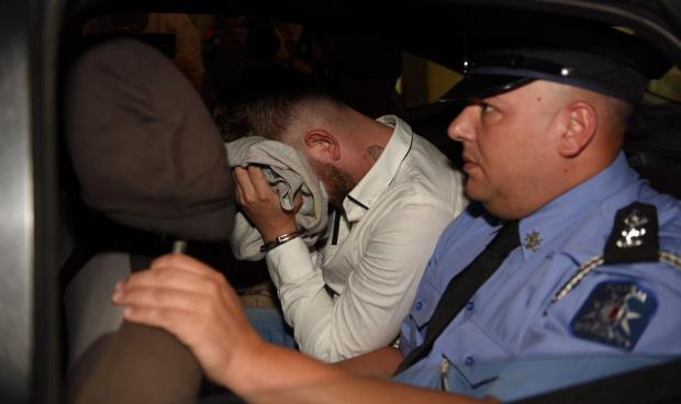 The accused being driven to court. Photo: Mark Zammit Cordina