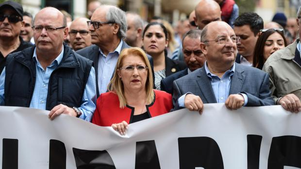President Coleiro Preca, flanked by the police commissioner and Home Affairs Minister, at the solidarity march. Photo: Chris Sant Fournier