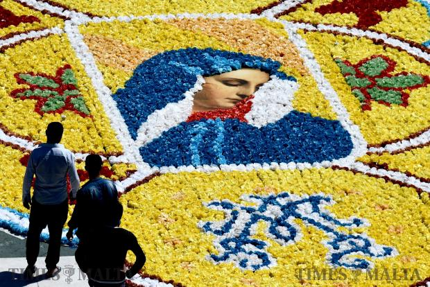 People admire a mosaic made out of plastic strips in Msida square on April 14. Photo: Jonathan Borg