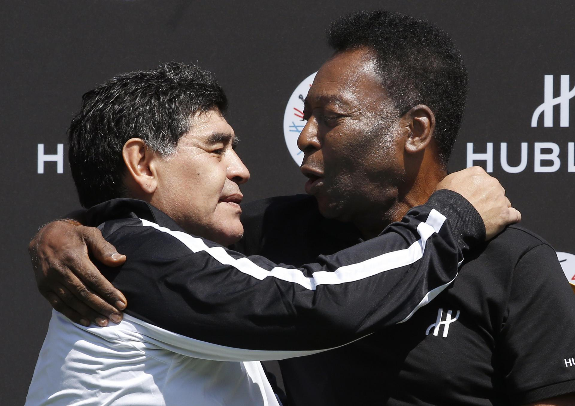 Maradona and Pele embrace: the two are considered to be the best footballers of all time. Photo: AFP