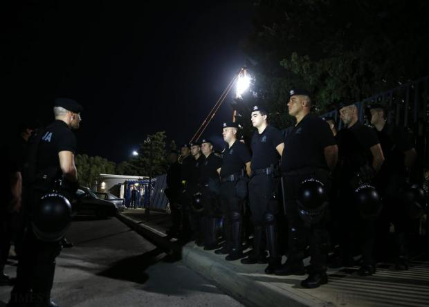 Riot police stand outside the National Stadium before the Euro 2016 Group H qualification soccer match between Malta and Croatia in Ta' Qali on October 13. Fears that Croatian fans, who were banned from entering the stadium, would turn up in large numbers and cause trouble did not materialise. Photo: Darrin Zammit Lupi