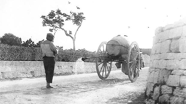 A bexxiex sprinkling a street with water to dampen the dust, 1880. Photo: Michael Cassar