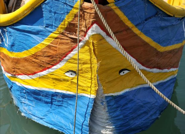 A luzzu fishing boat wears a protective cover in Marsaxlokk on July 26. Photo: Chris Sant Fournier