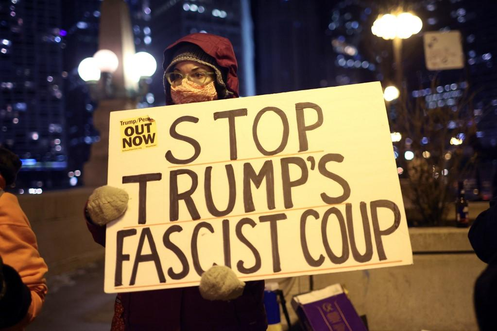 Protesters stand outside Chicago's Trump Tower on January 7. Photo: AFP