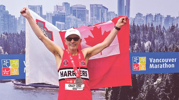 Joseph Camilleri flew the Maltese and Canadian flags at the Vancouver marathon where he came first in his age group category.
