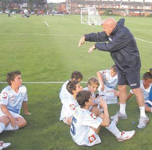 Motivator... Ray Farrugia giving instructions to young players attending his school.