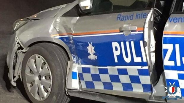 At one point, the man reversed into a police car.