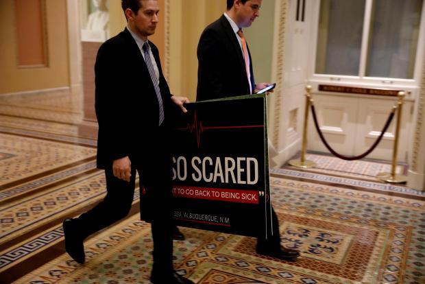 Holdouts break as Senate votes to debate repeal