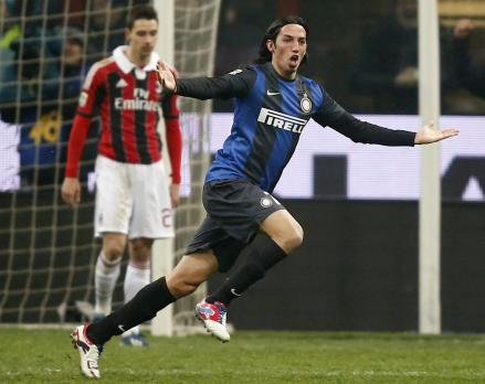 Inter's Ezequiel Schelotto celebrates after scoring against AC Milan