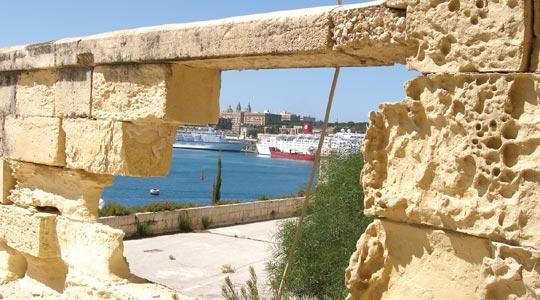 Valletta Waterfront seen through a gaping hole of a dilapidated wall in lower Fort St Angelo in Vittoriosa. Heritage Malta says it could cost about €15 million to restore the fort.