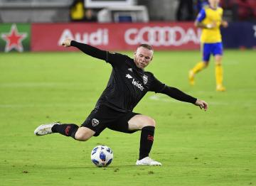 D.C. United forward Wayne Rooney (9) passes the ball against the Colorado Rapid during the second half at Audi Field. Credit: Brad Mills-USA TODAY Sports