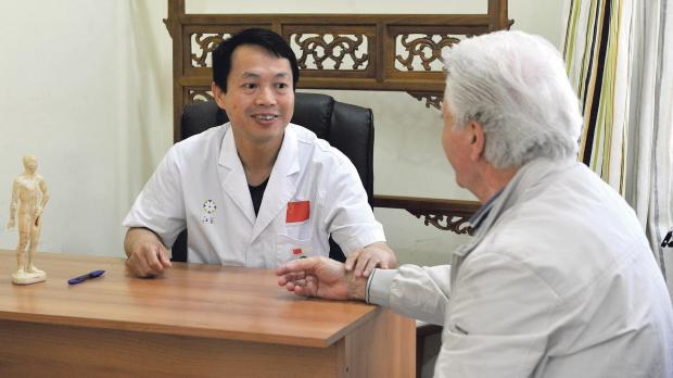 Dr Shi Jiangfeng (left), TCM Consultant from the 14th China Medical Team
