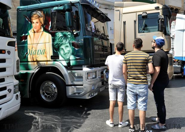 Three young men admire the spray job on a truck showing the late Princess Diana at the Hamrun Car Show on May 28. Photo: Chris Sant Fournier