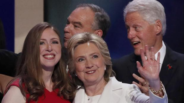 Daughter Chelsea and husband Bill were both present as Hillary made US political history. Photo: Reuters