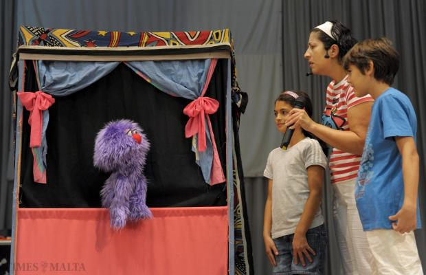 Two students are brought on stage during a puppet show at the Papa Gwanni Pawlu Parish church in Attard on August 29. Photo: Matthew Mirabelli