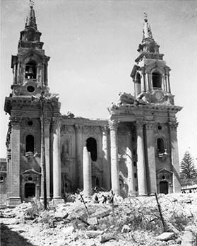 Barbed wire cordoned Granaries Square while residents rummaged the ruins. The portico of the church supported by the colonnade were gone as were statues in the niches. The main door and all the woodwork were shattered.