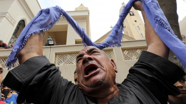 A relative of one of the bombing victims despairs. Photo: Reuters/Mohamed Abd El Ghany