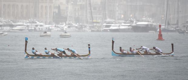 Rowers battle out the final push in heavy rain during the Victory day regatta races held in the Valletta Grand Harbour on September 08. Photo: Mark Zammit Cordina