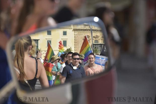The reflection in a motorcycle mirror at the annual Gay Pride Parade on June 11. Photo: Mark Zammit Cordina