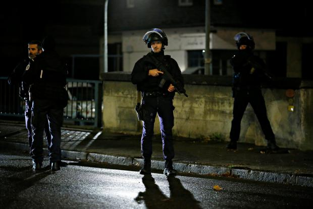 Police secure area where a suspect is sought after a shooting in Strasbourg.