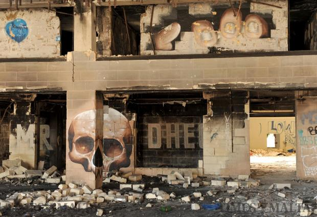 Graffiti of a skull that comes together when standing in a particular spot decorate the walls of the dilapidated Jerma Palace in Marsascala on June 25. Photo: Chris Sant Fournier