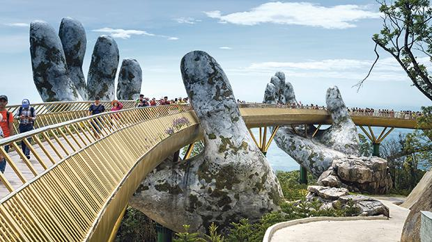 The Golden Bridge is lifted by two giant hands in the tourist resort on Ba Na Hill in Danang, Vietnam. Ba Na Hill mountain resort is a favourite destination for tourists. Photos: Shutterstock.com