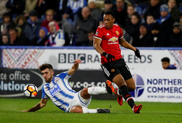 Manchester United's Anthony Martial in action with Huddersfield Town's Tommy Smith.