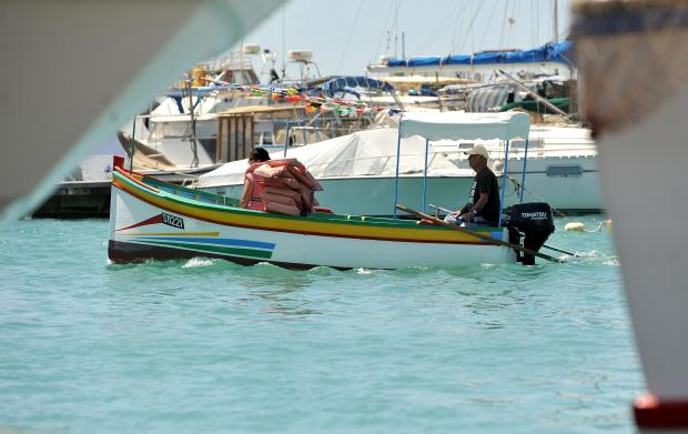 A boat crosses the Marsaxlokk harbour on May 23. Photo: Chris Sant Fournier