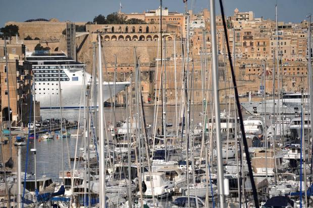 The cruise ship Costa Mediterranea is seen docked in Valletta through a forest of yacht masts in Vittoriosa on February 8. Photo: Chris Sant Fournier