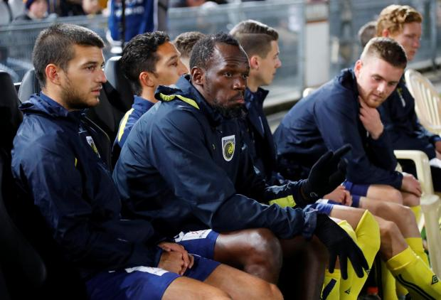 Andrija Majdevac (left) sitting alongside Usain Bolt during yesterday's friendly against the Central Coast selection.