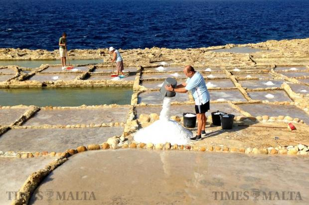 A man collects salt from the salt pans in Qbajjar in Gozo on September 10. Photo: Chris Sant Fournier