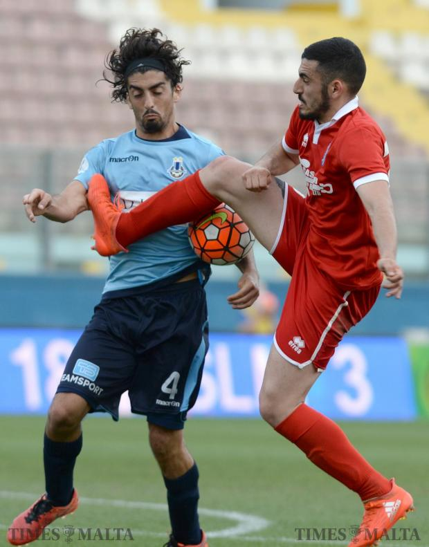 Tarxien Rainbow's Sacha Borg (right), goes in for the ball against Sliema's Matias Muchardi during their FA trophy match at the National Stadium in Ta'Qali on May 13. Photo: Matthew Mirabelli