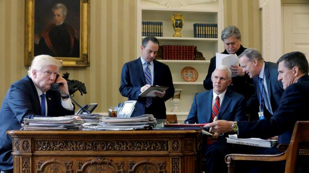 And then there was one...Trump sits on the left with chief of staff Reince Priebus, vice-president Mike Pence, strategist Steve Bannon, spokesman Sean Spicer and national security advisor Michael Flynn. Only vice president Pence remains in the White House. Photo: Reuters