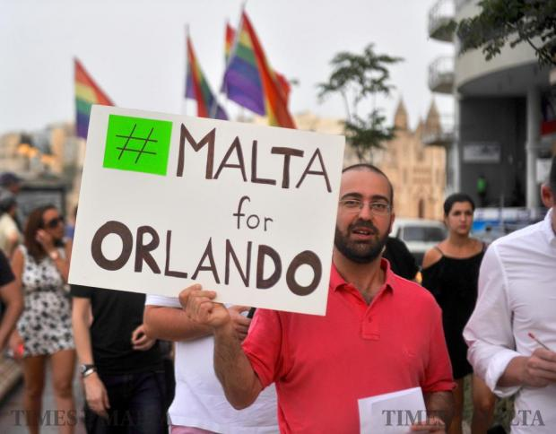 Over 200 people participate in a symbolic walk to the Love monuement in St Julian's on June 17, to remember the 49 people that lost their lives in a horrific mass killing in Orlando, USA. Photo: Steve Zammit Lupi